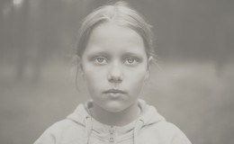 Black and white portrait of tired little girl with sad eyes. Shallow DOF